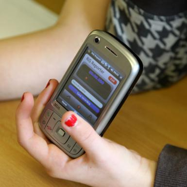 Photo of phone with AudioEnable by Nomos Media and Radio in Schools