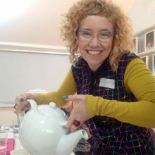Lisa Heledd Jones getting to grips with the world's biggest teapot at NTW. via @