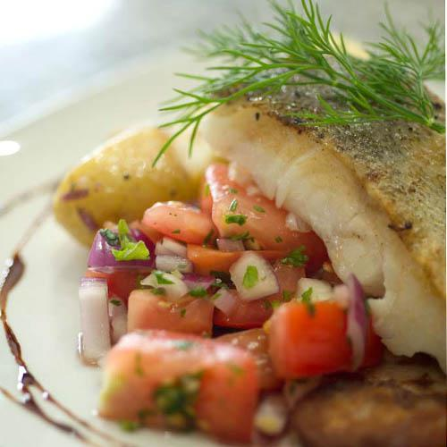 A plate of pan fried cod with potatoes and vegetables