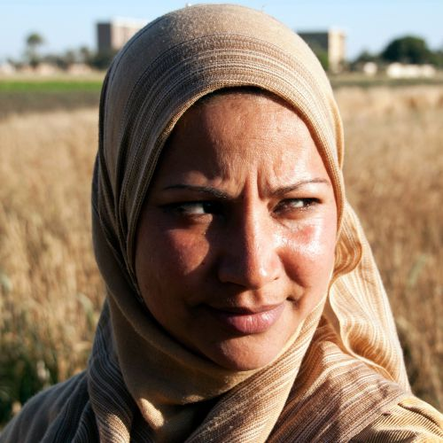 Egypt Now: In The Shadow of a Man - woman in headscarf