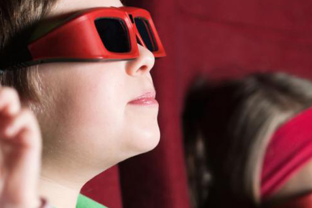 Photo of a boy wearing 3d glasses