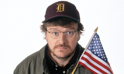 Michael Moore holding the US flag.