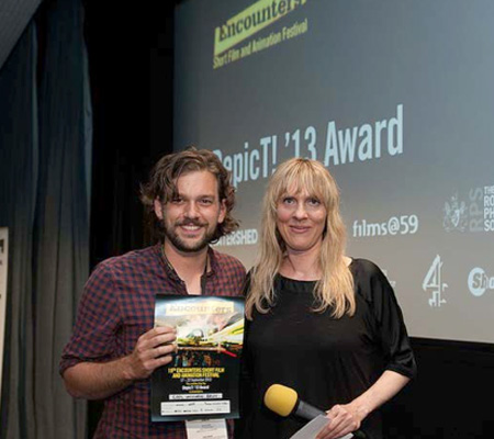 DepicT! 2013 winner Ninian Doff receives one of his awards
