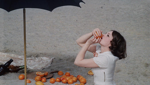 Woman eating fruit on beach