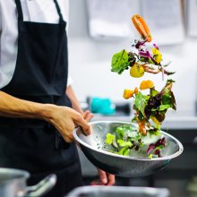 Photo of a chef cleaning salad at Watershed
