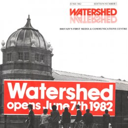 Watershed building with the date it opened across the image.