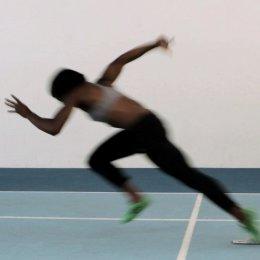 Athlete running off the starting blocks