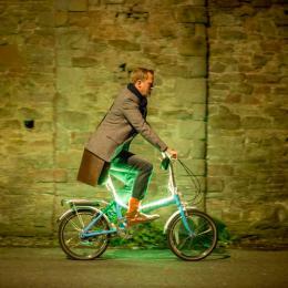 Man on illuminated bike