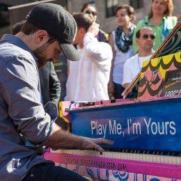 Man playing a piano outside