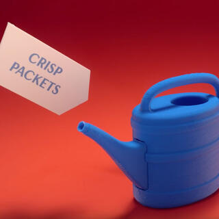 Photo of a watering can made out of crips packets