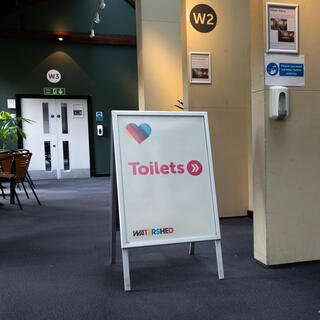 Sign at Watershed pointing to the toilets