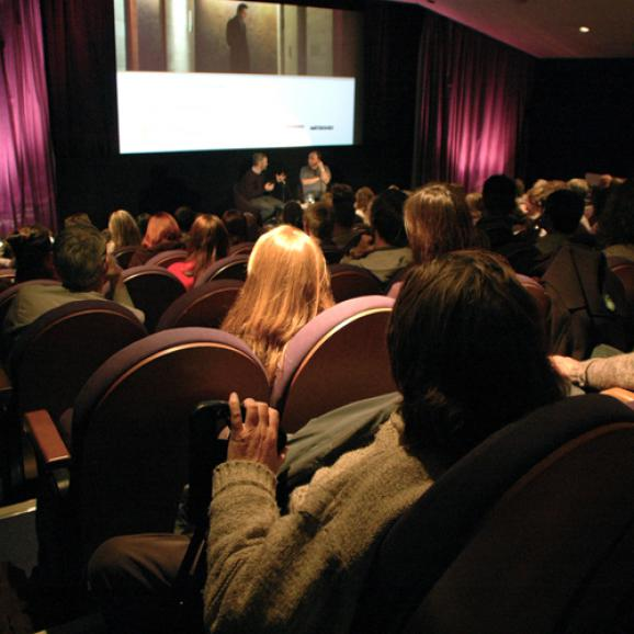 A full cinema at a talk and screening.