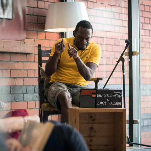 David Ellington, a Deaf Bristol artist and filmmaker, reading Matilda at last Friday's Read-in-a-day (Credit: Jon Aitken)