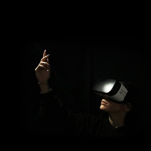 Person dancing with VR headset on