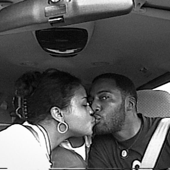 Woman and man kissing in a car