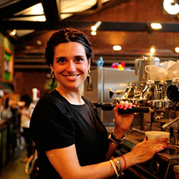 Phot of a Watershed Café & Bar team member making coffee