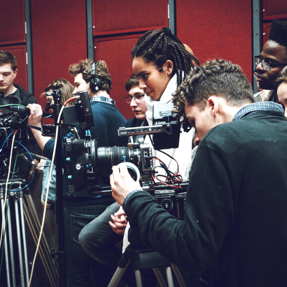 Young people as part of camera crew