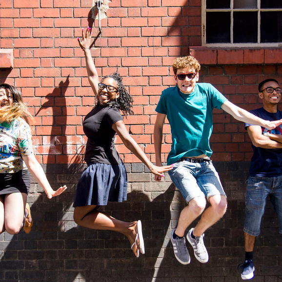 4 young people from Rife Magazine jumping in the air