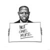 Black man holding a sign which says 'Not one more'.