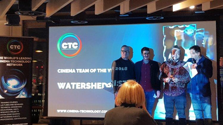 Watershed team on stage receiving award