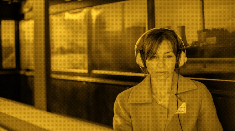 Photo of a woman wearing headphones