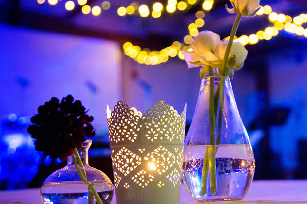 Dressed candle lit table with flowers
