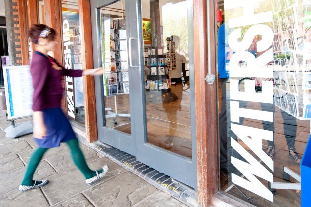 Photo of the front doors of Watershed with someone walking in