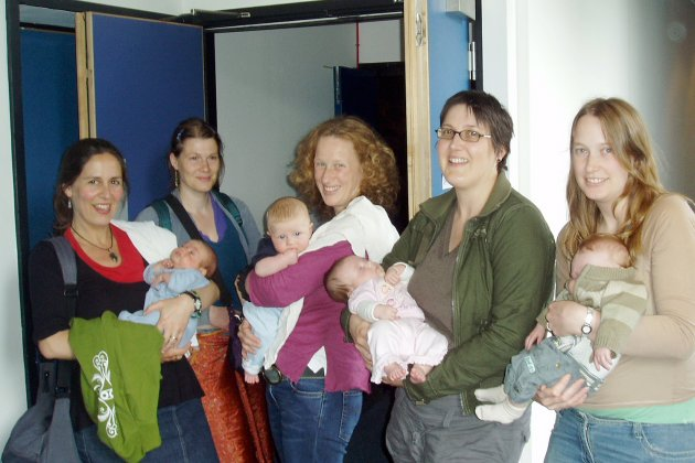 Mothers and babies standing outside a Watershed cinema, ready for a cinebabies screening