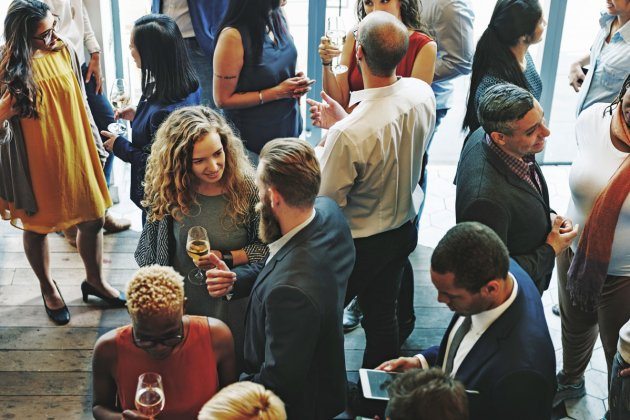 Photo of people chatting at a networking event