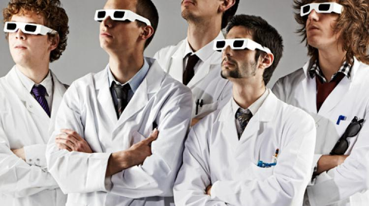 5 men in lab coats and 3d glassess looking up