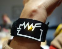 "Picture of a women wearing a ""WF"" bracelet"