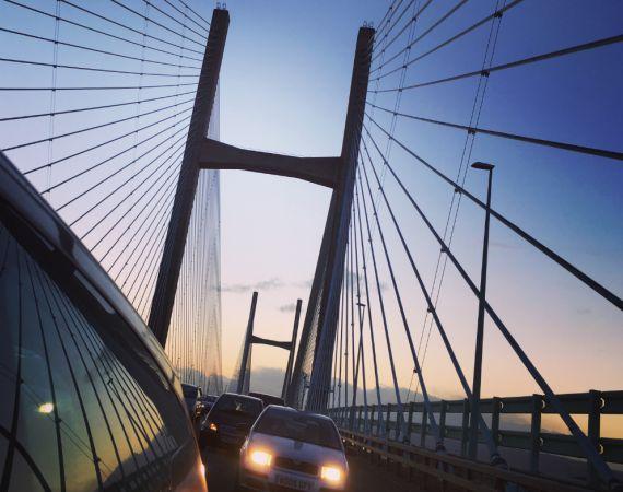 Car headlights on suspension bridge