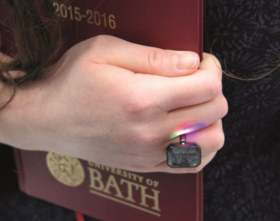 Hand with Ringly holding diary