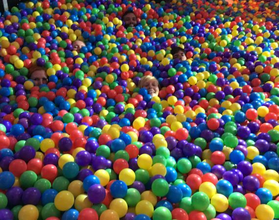 Studio team in a giant ball pit