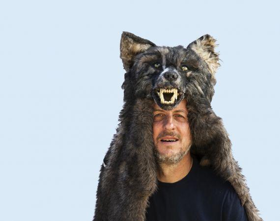 Simon Evans wearing a wolf headress